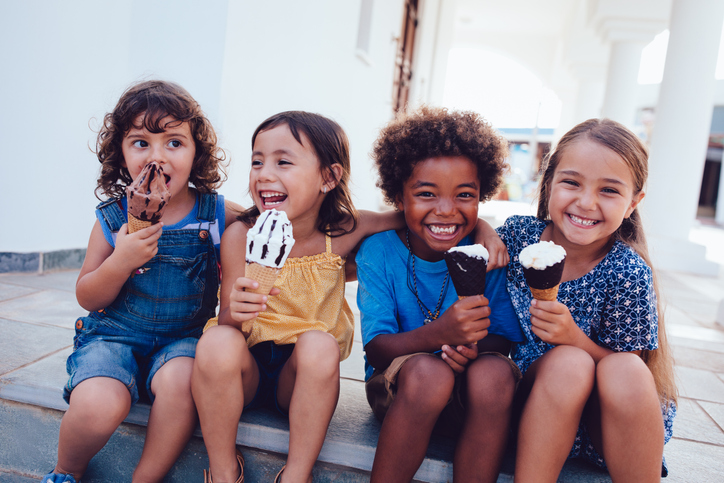 Happy children eating ice cream after successful child therapy and treatment