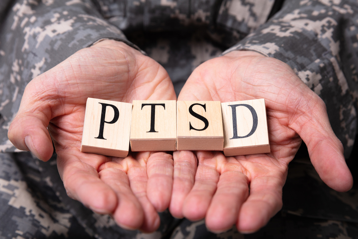 Military Soldier holding PTSD Cubes seeking Treatment for PTSD