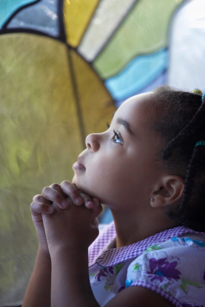 Photo of child praying in christian counseling
