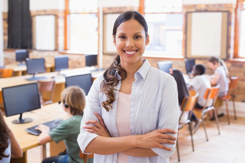 Woman in classroom smiling because of christian counseling