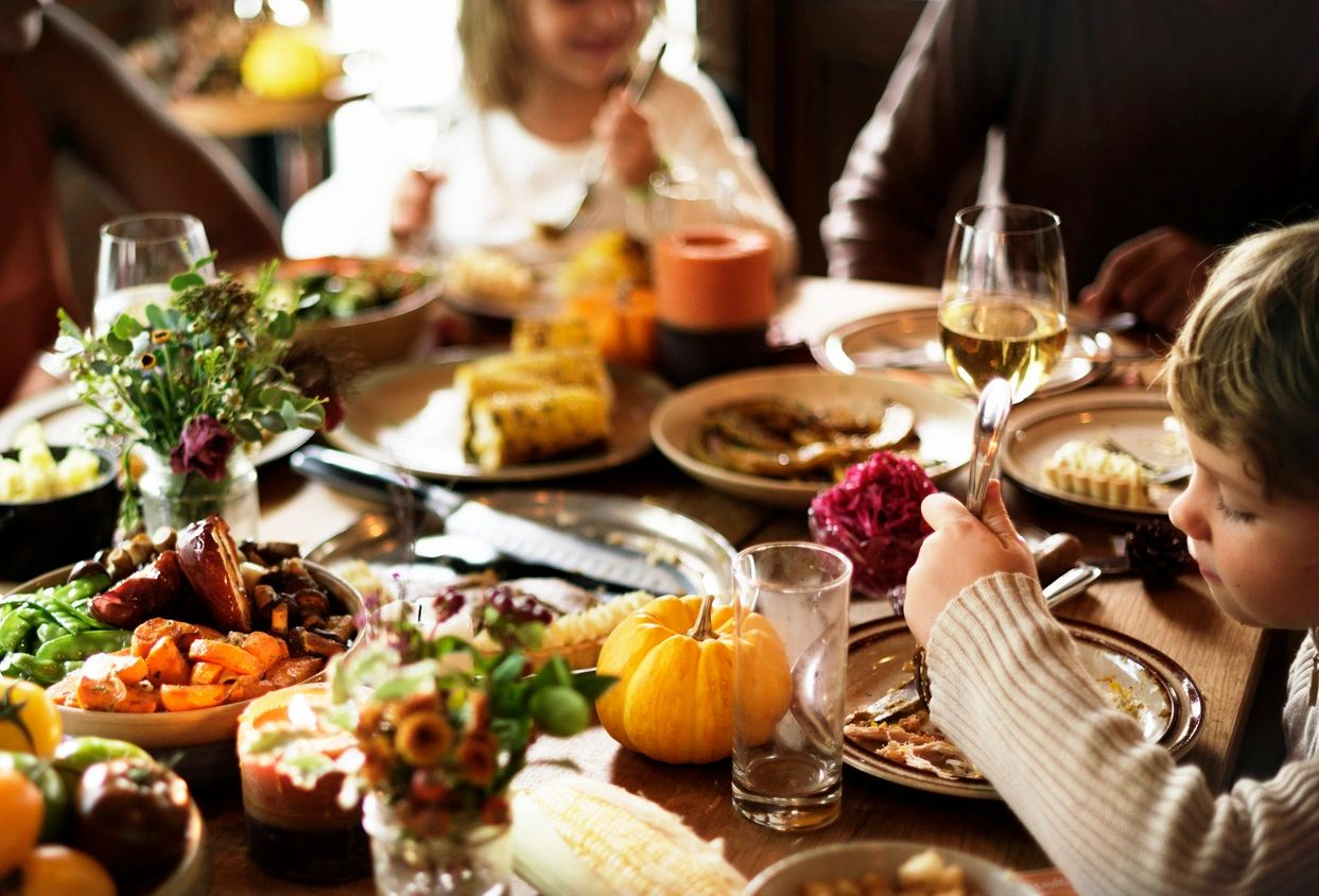 Thanksgiving gathering with family enjoying the holidays with low stress and no anxiety