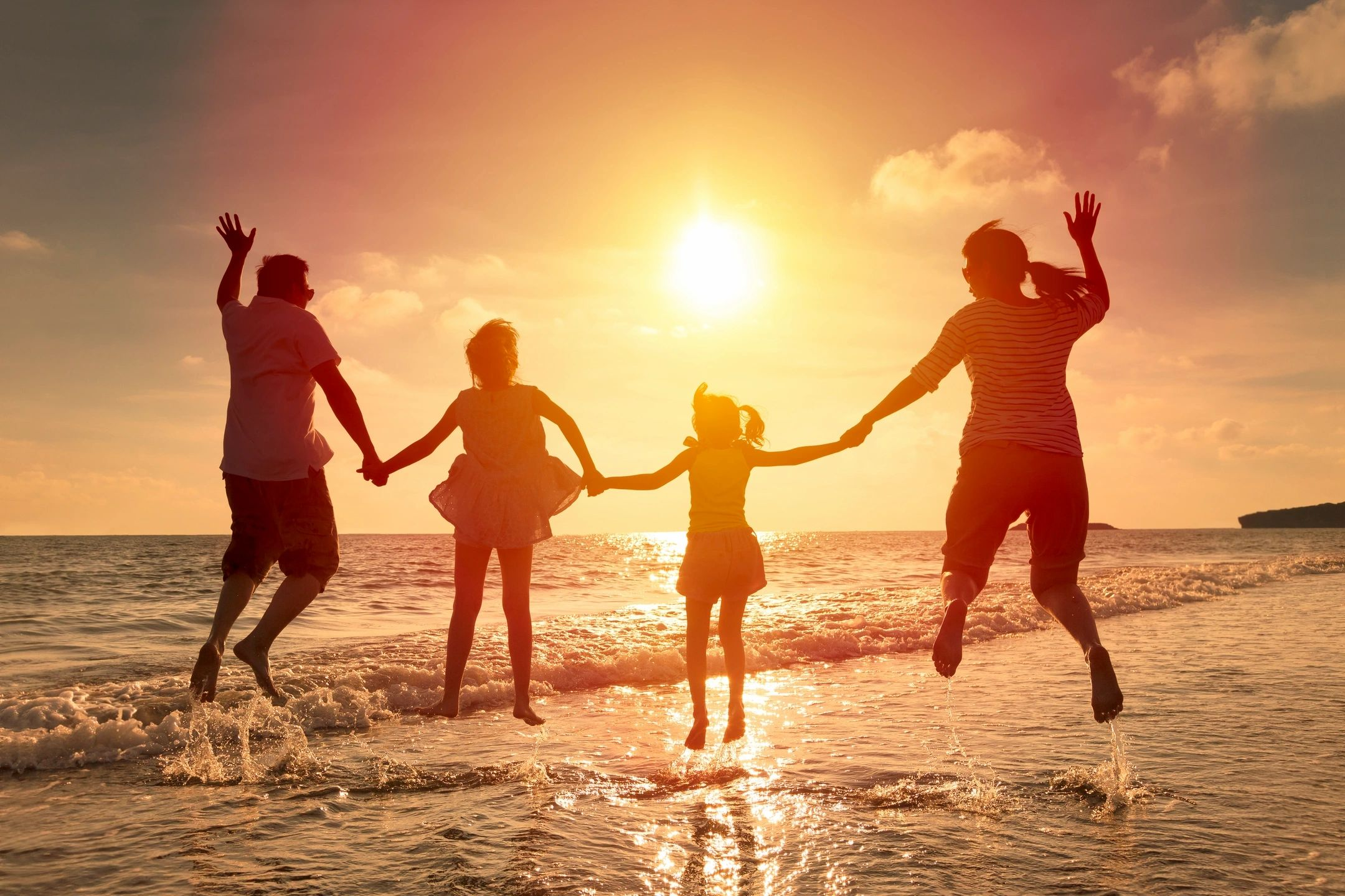 attitude of gratitude displayed by family on the beach